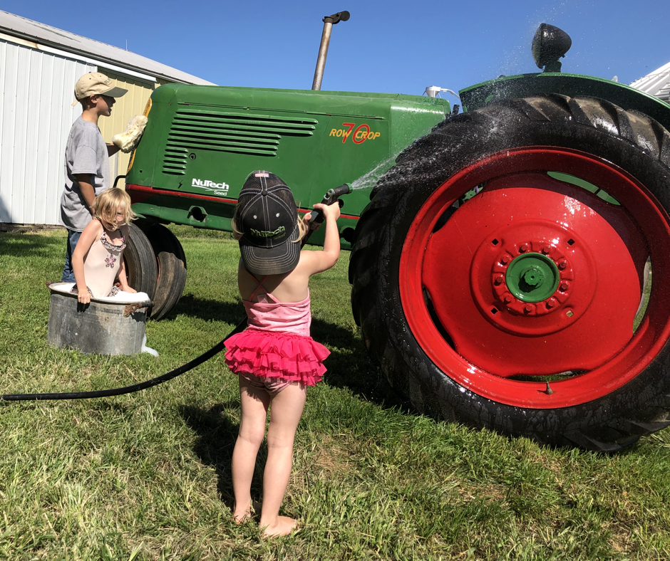 three of our kids make the most of the last days of summer while washing our oliver70