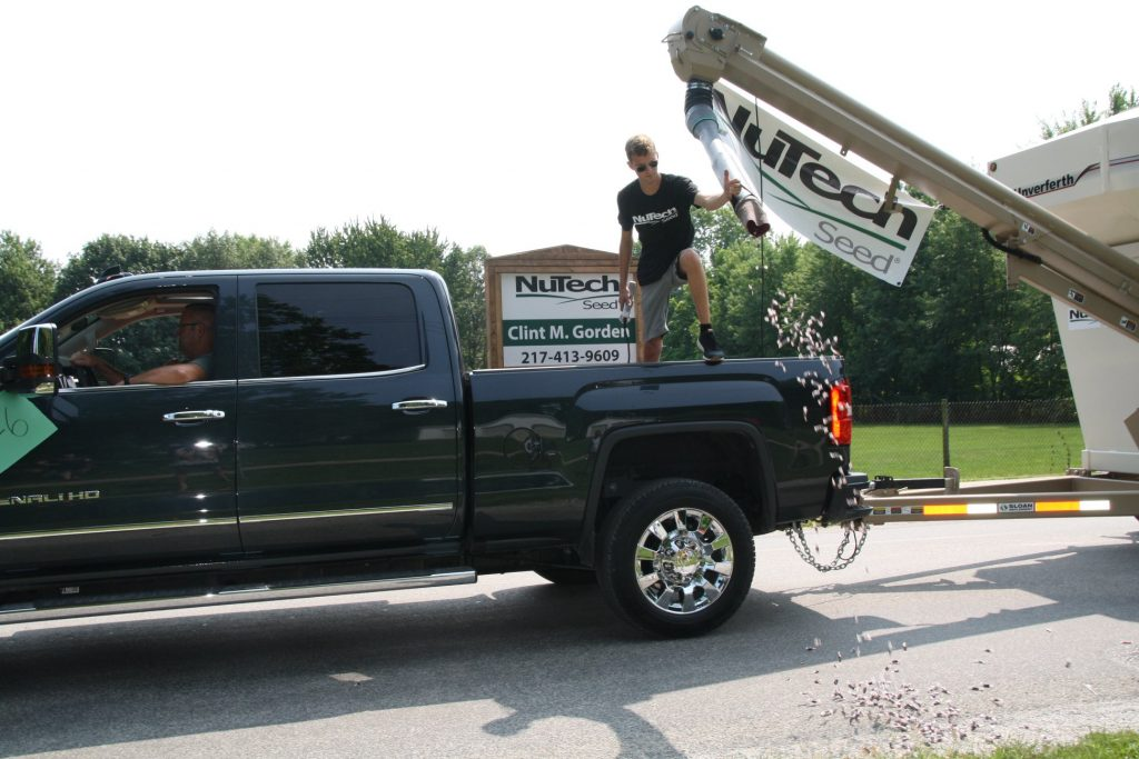 shooting 300 pounds of tootsie rolls out of a seed tender in hometown parade